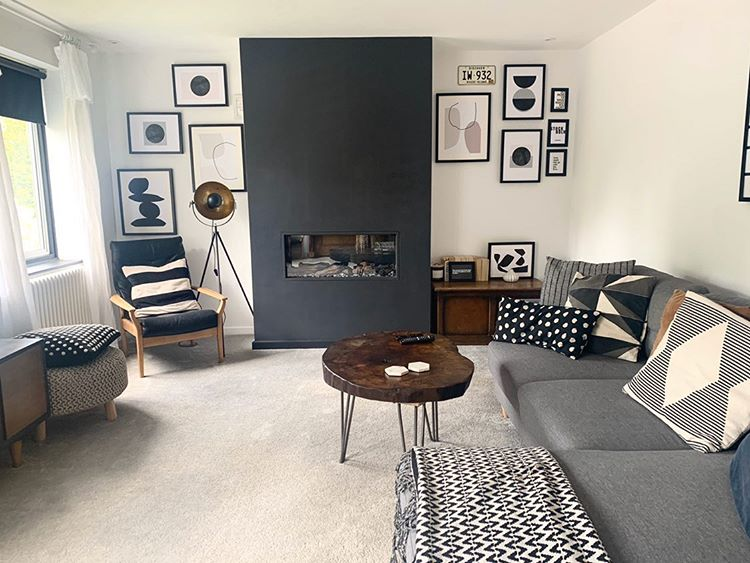 A monochrome living room with monochrome soft furnishings and monochrome paint