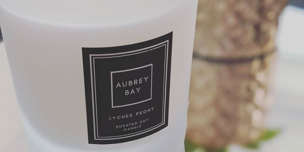 A Aubrey Bay natural candle with a monochrome candle aesthetic