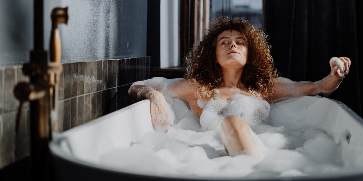 women having a bath with relaxing essential oils